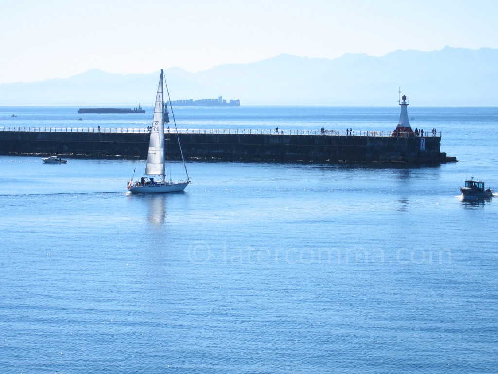 sailboat heading out into the Strait of Juan De Fuca